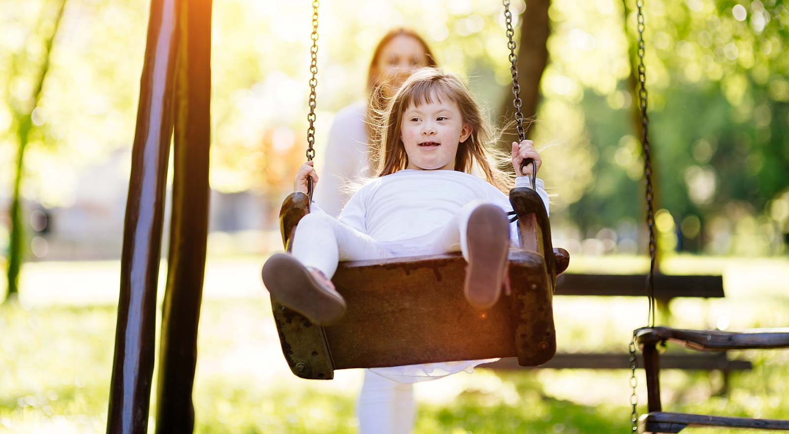 Disbled child playing on a swing
